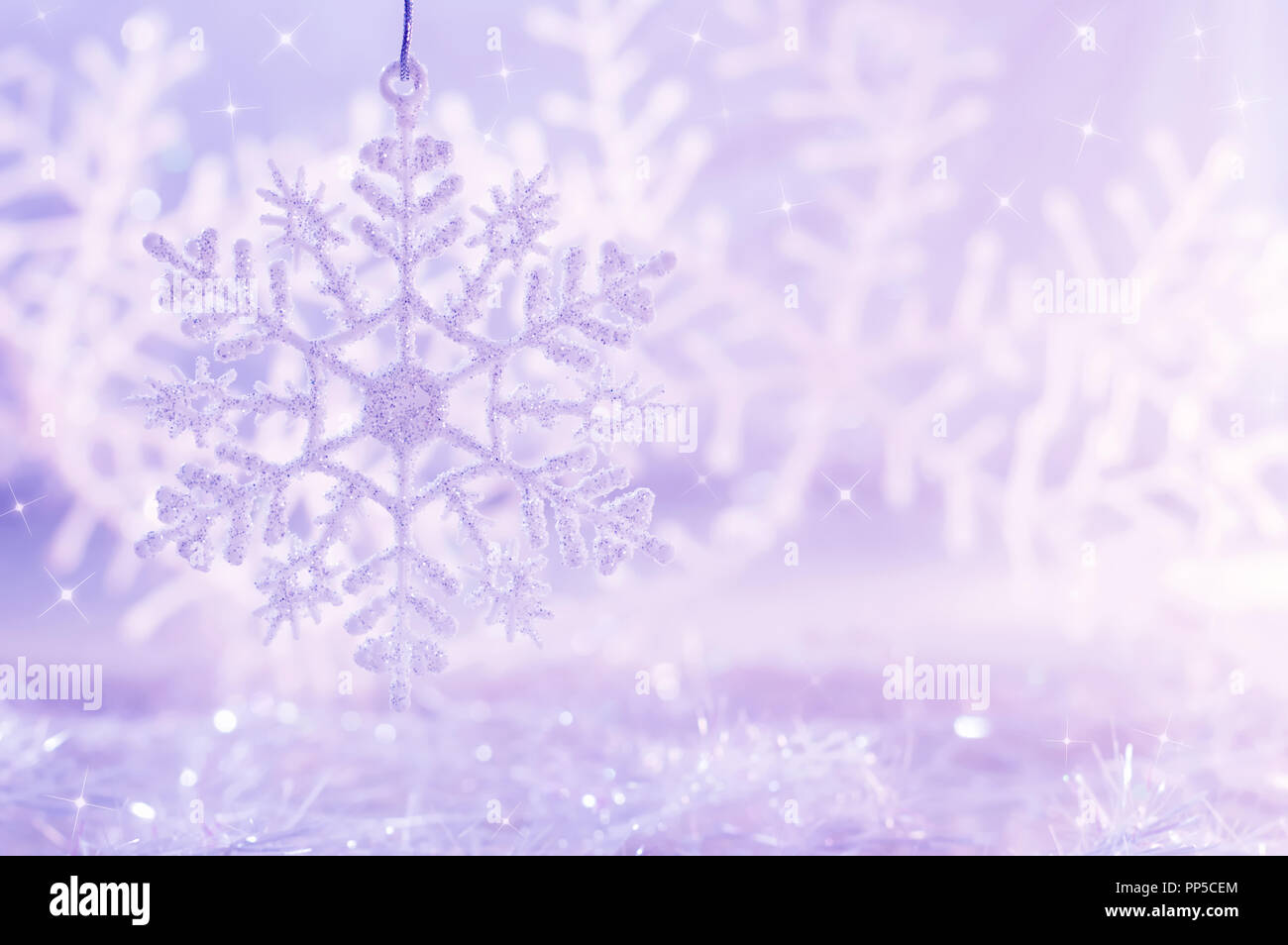light purple background with snowflakes christmas background stock