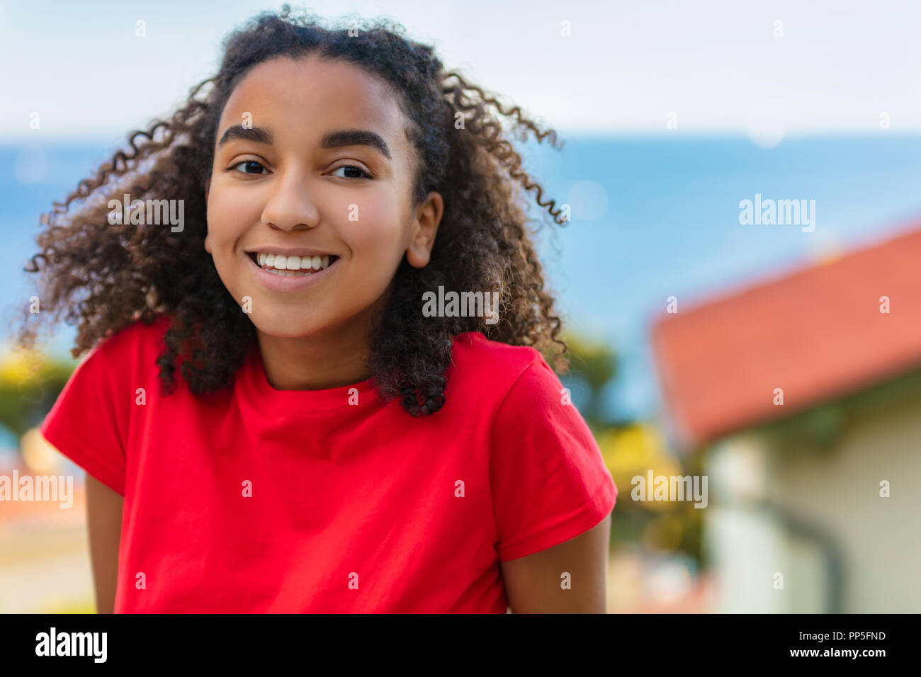 Perfect Teenager Part - 19: Outdoor portrait of beautiful happy mixed race African American girl  teenager female young woman smiling with perfect teeth and the sea  coastline behi