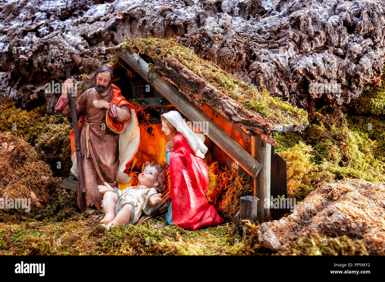 Close-up of the Christmas Nativity scene. Hut with baby Jesus in the manger, with Mary and Joseph. Stock Photo