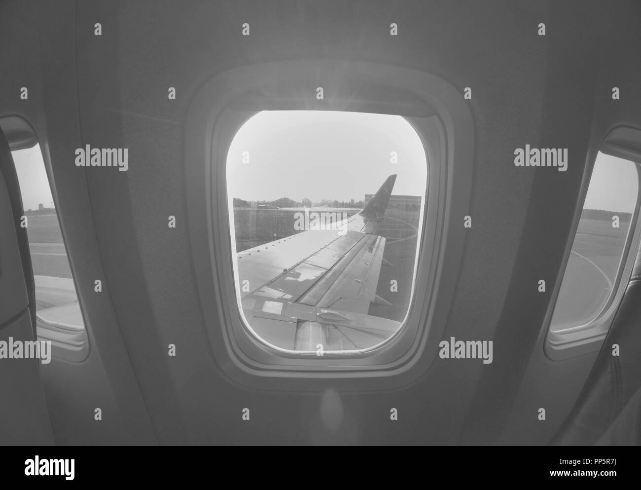 Aiplane Aircraft windows view on the wing aircraft, airlines , aviation skyline transportation - Stock Image