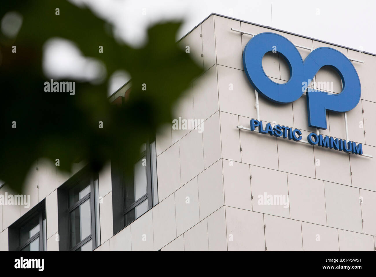 A logo sign outside of a facility occupied by Plastic Omnium in Munich, Germany, on August 31, 2018. - Stock Image