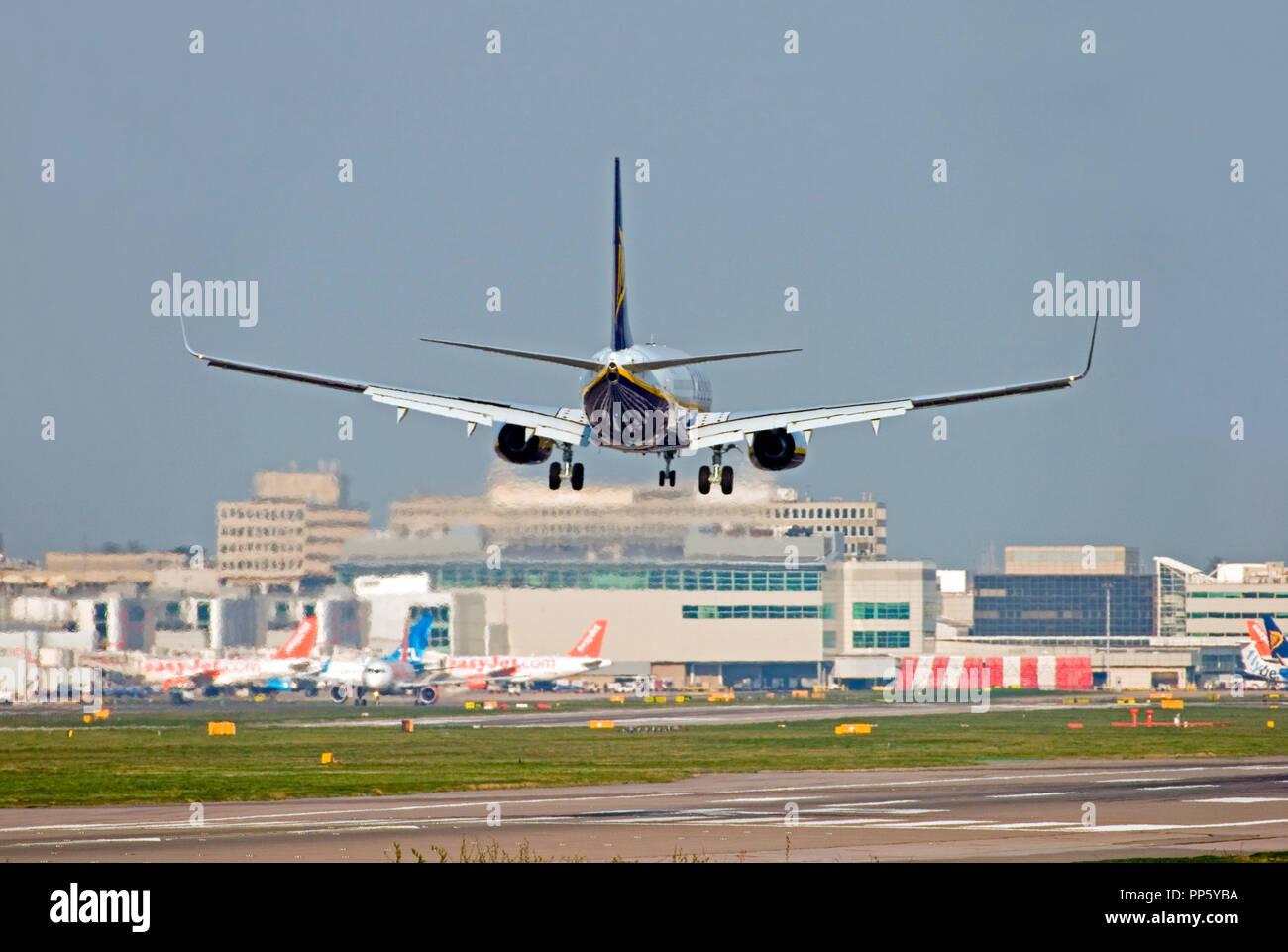 Ryanair Boeing 737-8AS aircraft landing at London Gatwick airport. - Stock Image