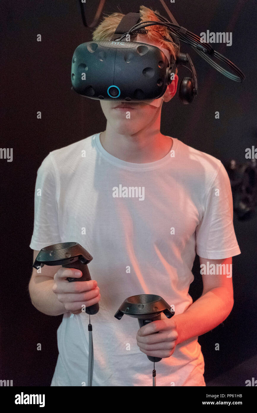 ea74275d5055 Visitor with virtual reality glasses and controllers at the World of Tanks  stand at the world s largest computer and video games fair Gamescom in  Cologne