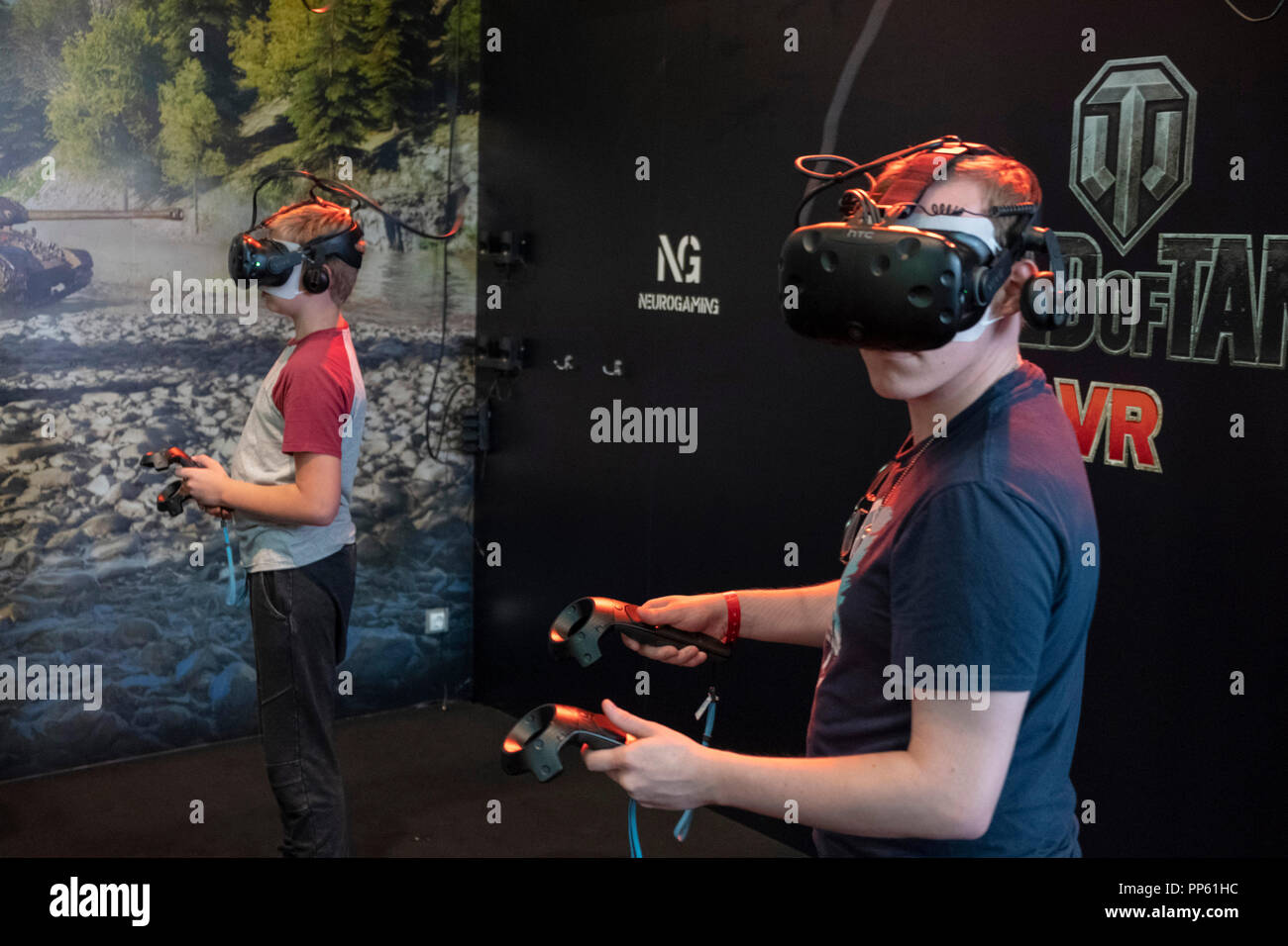 c03b40fab650 Visitors with virtual reality glasses and controllers at the World of Tanks  stand at the world s largest computer and video games fair Gamescom in  Cologne