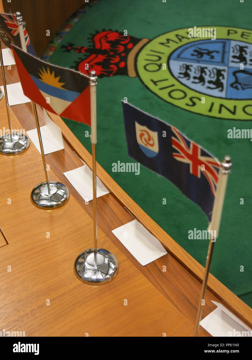 Nations' flags set out on the seminar-style benching in Courtroom 3 at the Supreme Court, Parliament Square, London UK - Stock Image