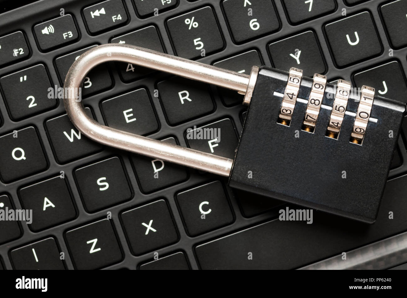 Combination lock on a computer keyboard.  Online security concept. - Stock Image