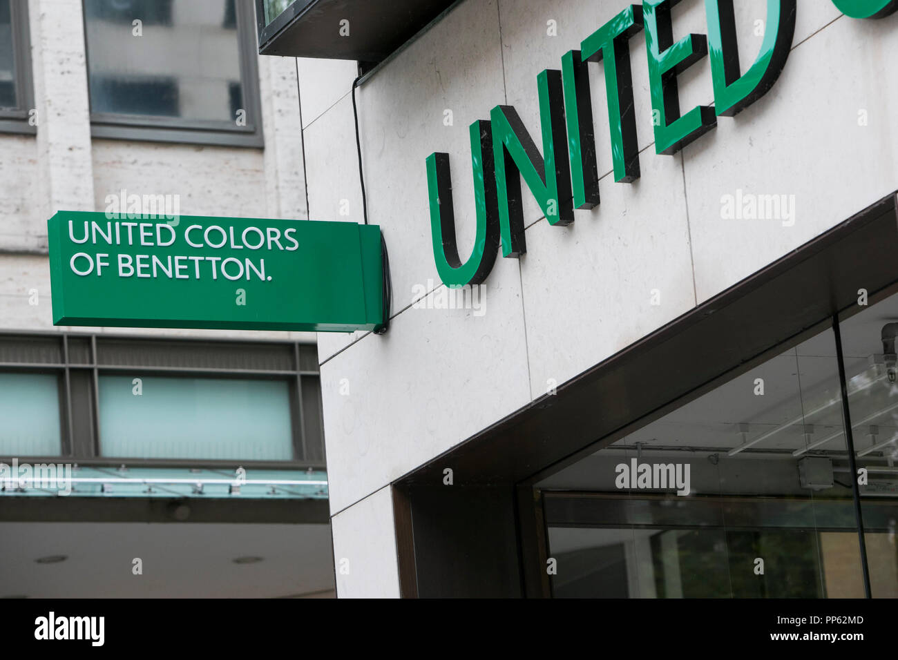 A logo sign outside of a United Colors of Benetton retail store in Munich, Germany, on September 2, 2018. - Stock Image