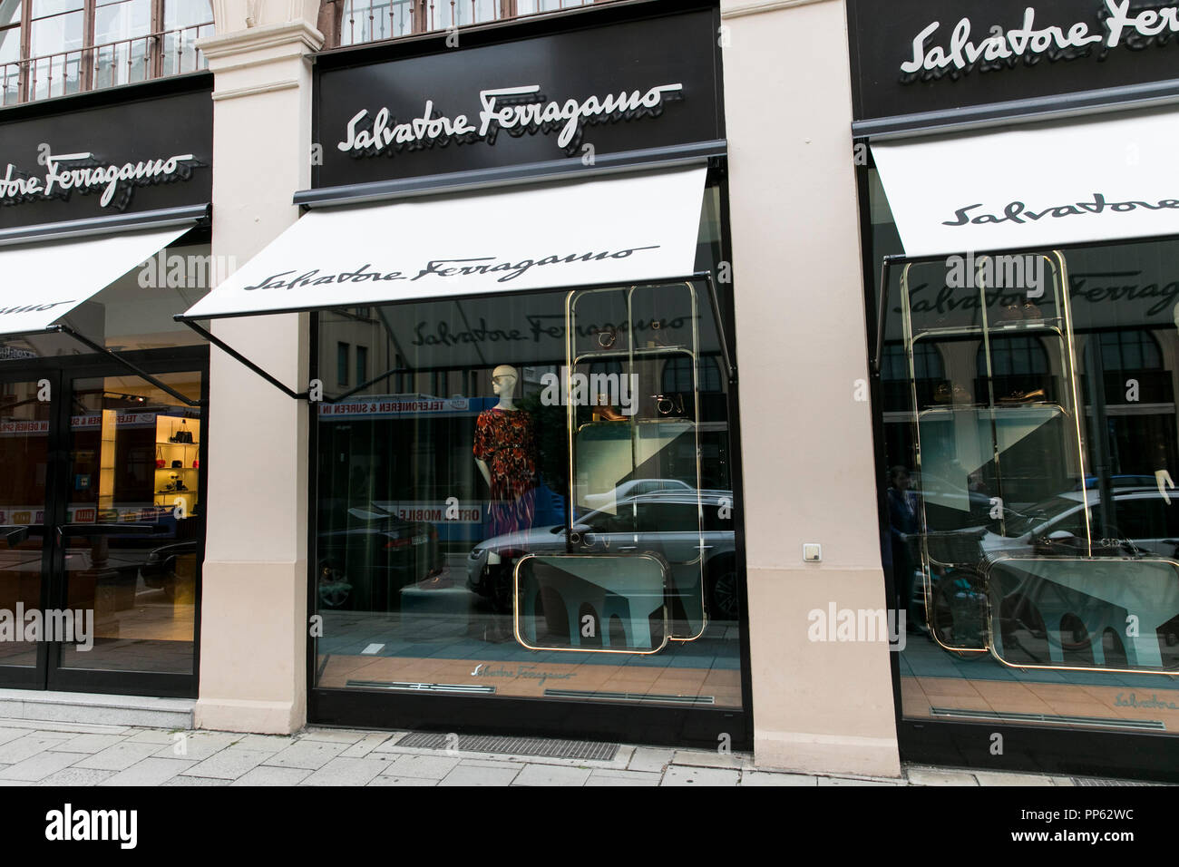 A logo sign outside of a Salvatore Ferragamo retail store in Munich, Germany, on September 2, 2018. - Stock Image