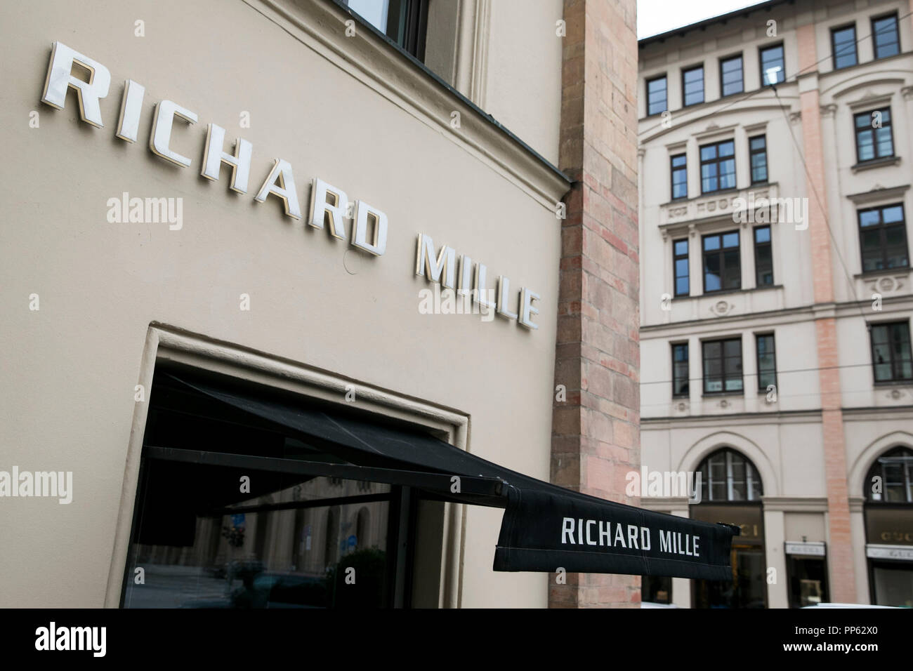 A logo sign outside of a Richard Mille retail store in Munich, Germany, on September 2, 2018. Stock Photo