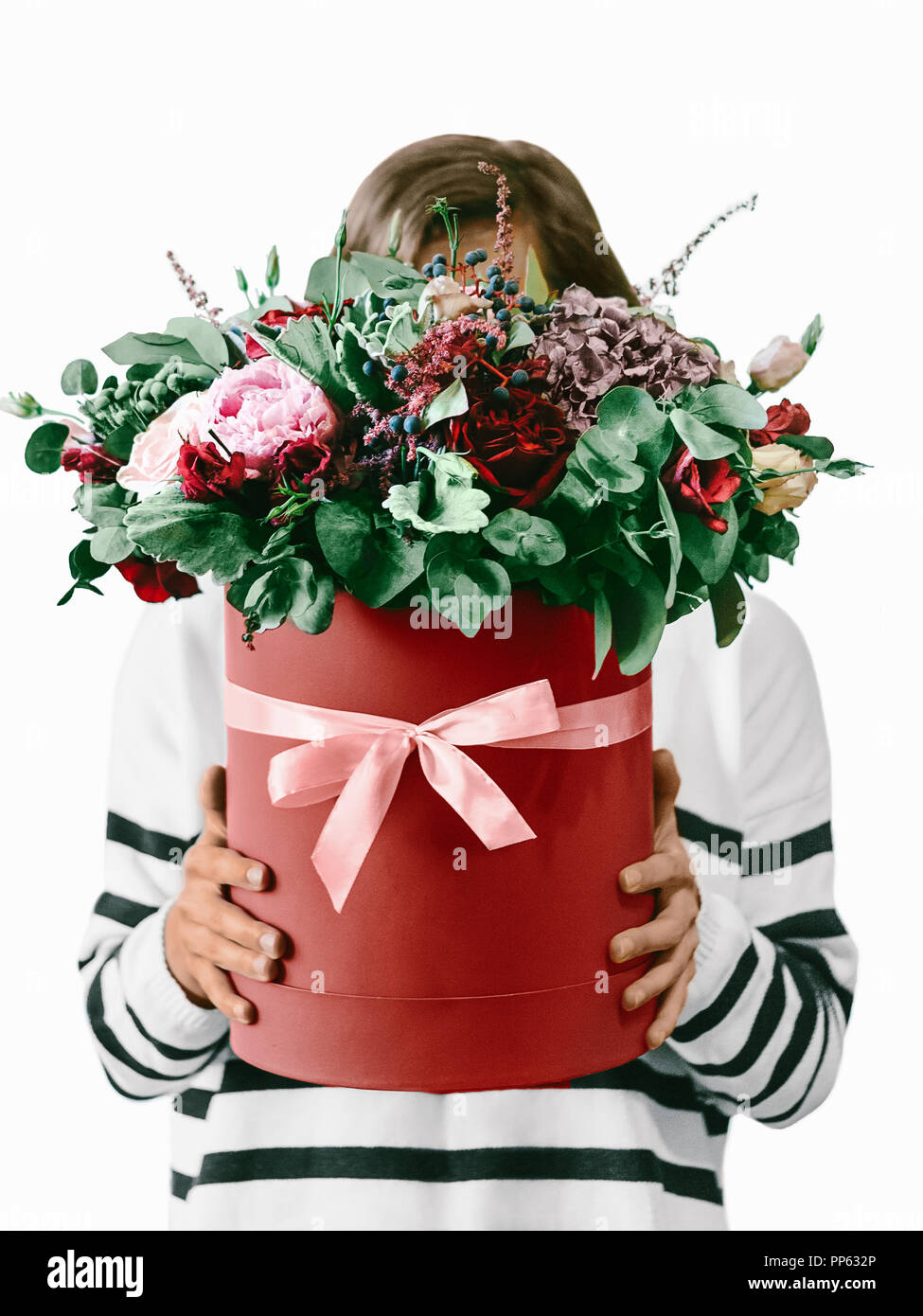 Girl With Flowers Against White Wall Close Up Photo Young Woman In A