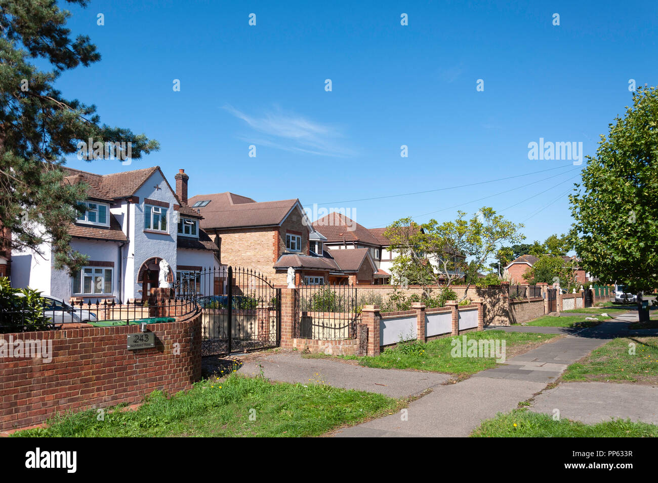 Detached houses on Ashford Road, Laleham, Surrey, England, United Kingdom - Stock Image