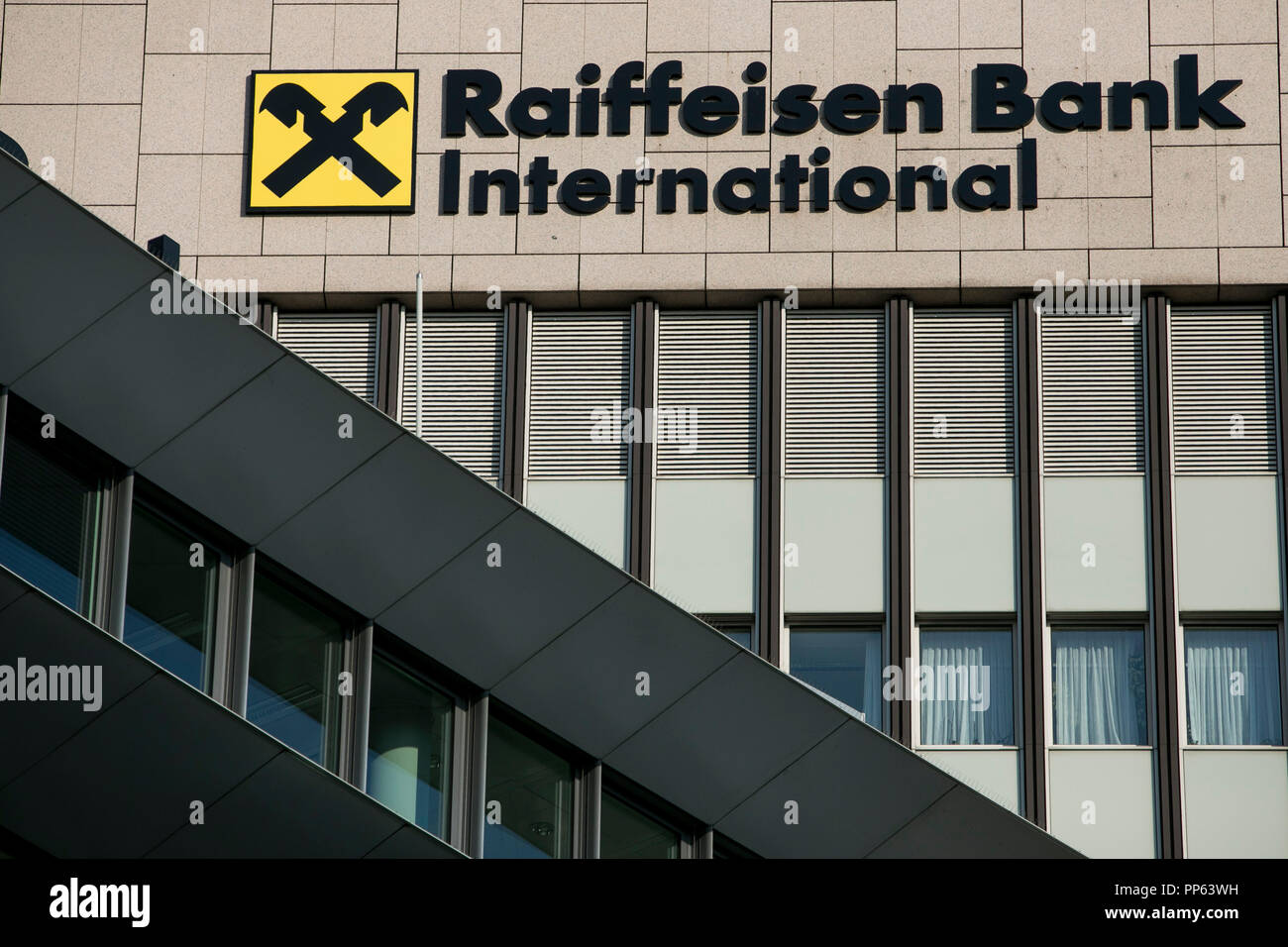 A logo sign outside of the headquarters of Raiffeisen Bank International (RBI) in Vienna, Austria, on September 5, 2018. - Stock Image