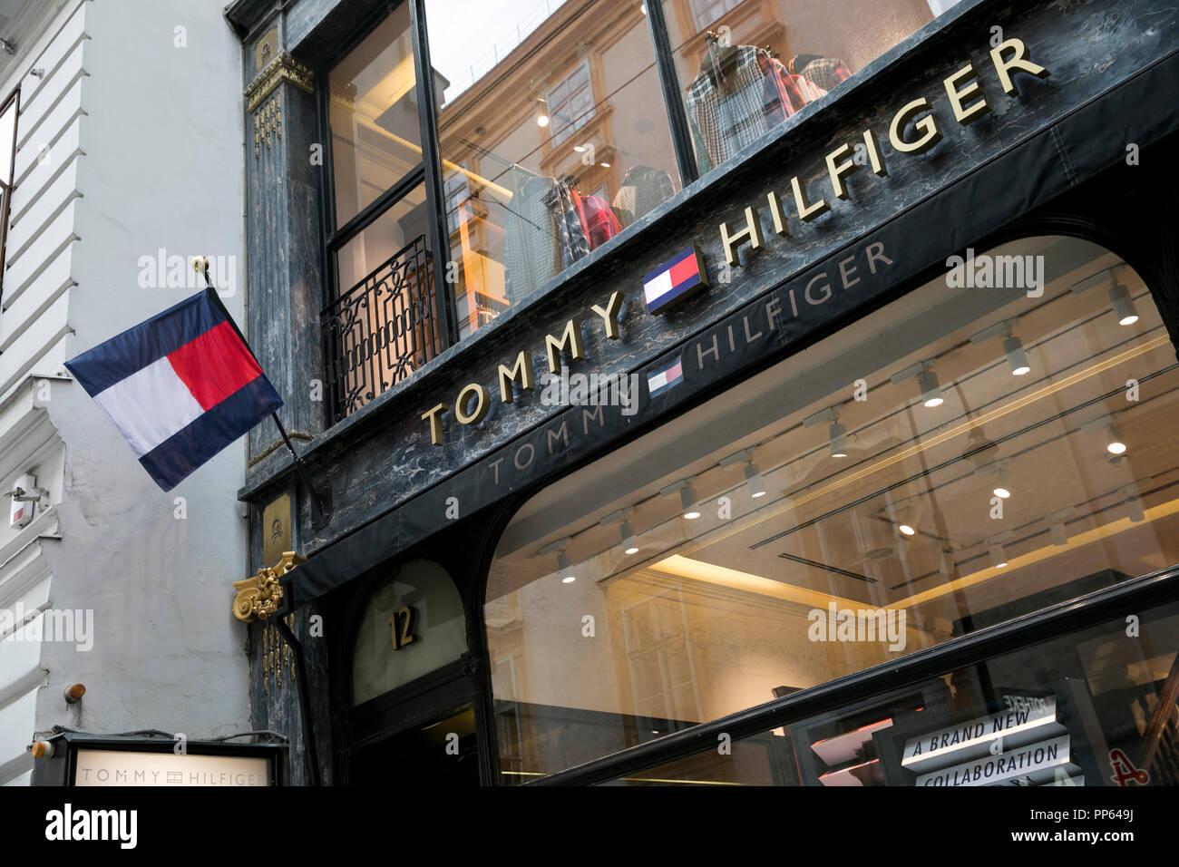 61a873ec A logo sign outside of a Tommy Hilfiger retail store in Vienna, Austria, on