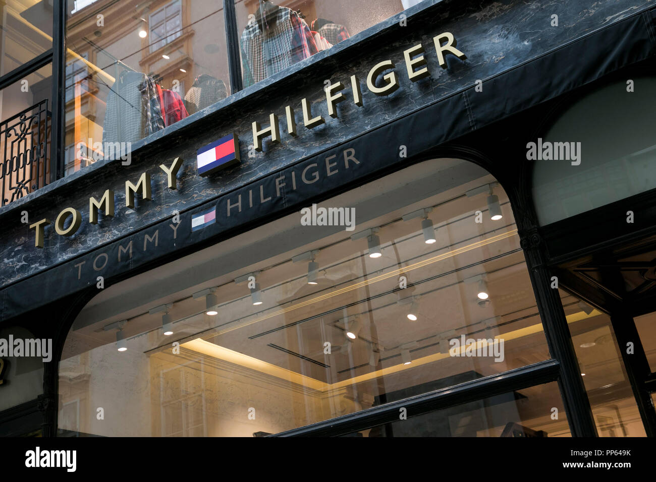 best service 44db2 fdc39 A logo sign outside of a Tommy Hilfiger retail store in ...
