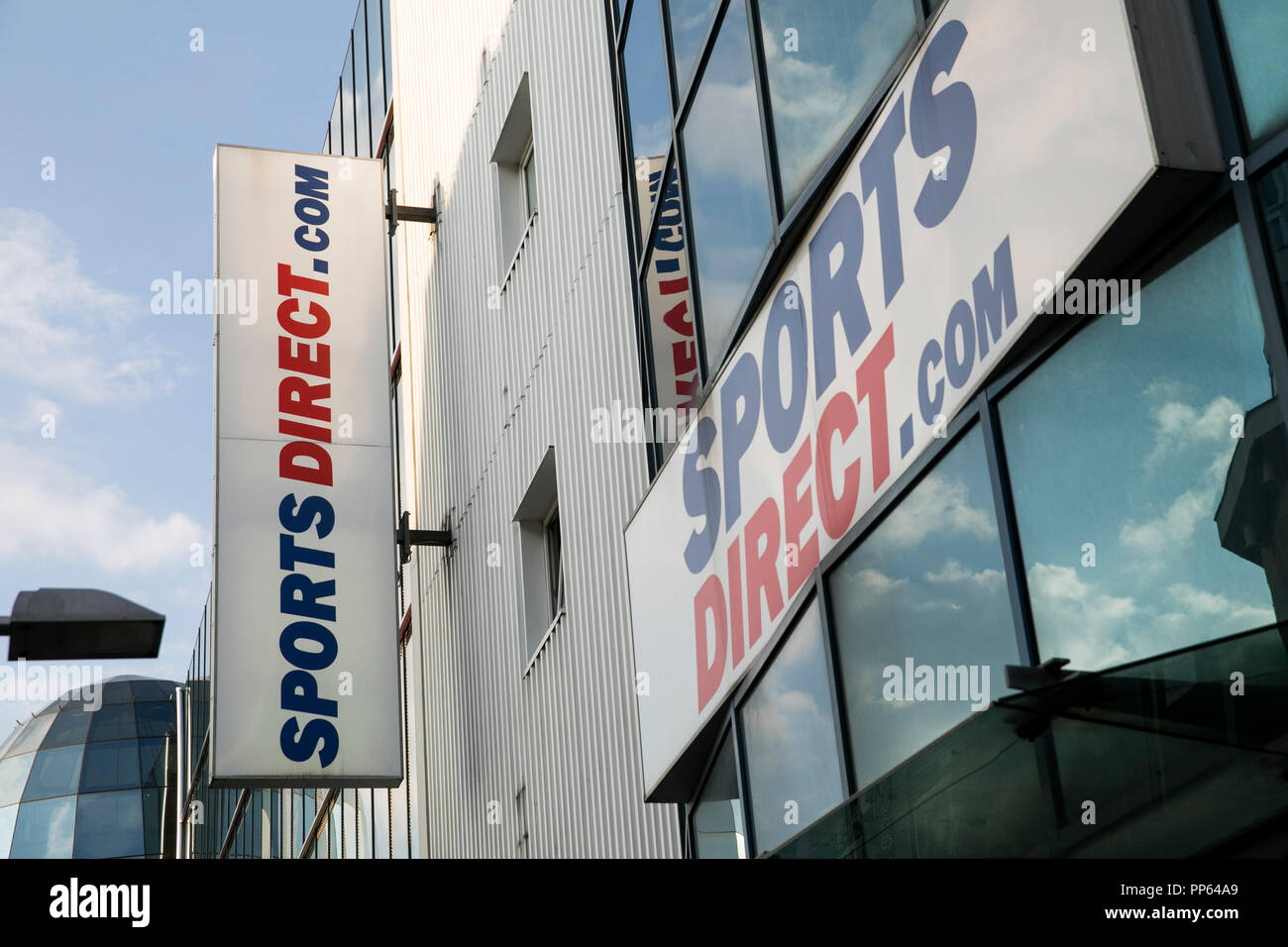 A logo sign outside of a Sports Direct International retail