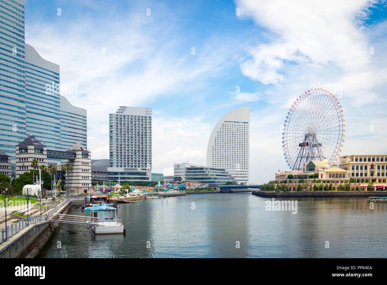The beautiful Yokohama skyline and Yokohama waterfront at Minato-Mirai, and the Cosmo Clock 21 Ferris wheel Yokohama, Kanagawa Prefecture, Japan. - Stock Image