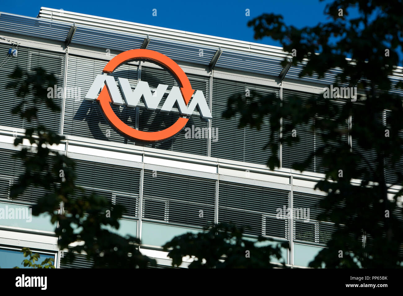 A logo sign outside of the headquarters of The Abfallwirtschaftsbetrieb München (AWM) in Munich, Germany, on September 8, 2018. - Stock Image