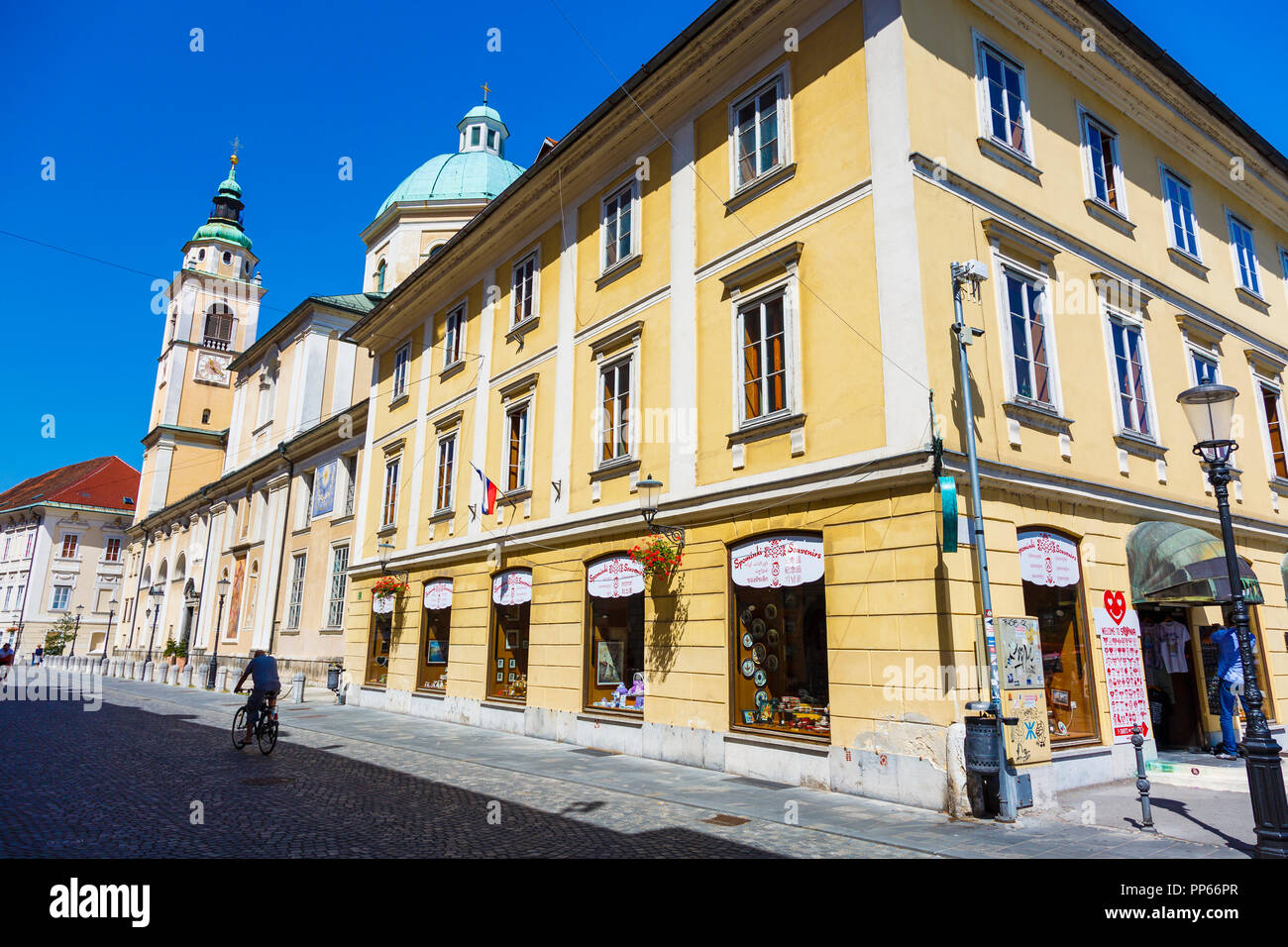 Edifice and Ljubljana Cathedral or St. Nicholas's Church. - Stock Image