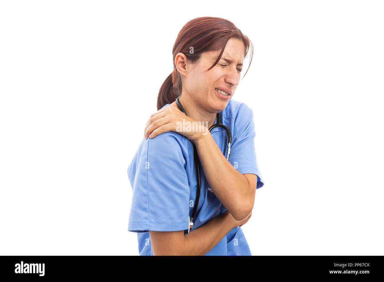 Injured hospital woman nurse or doctor holding painful shoulder and upset expression as clinic work injury concept isolated on white background - Stock Image