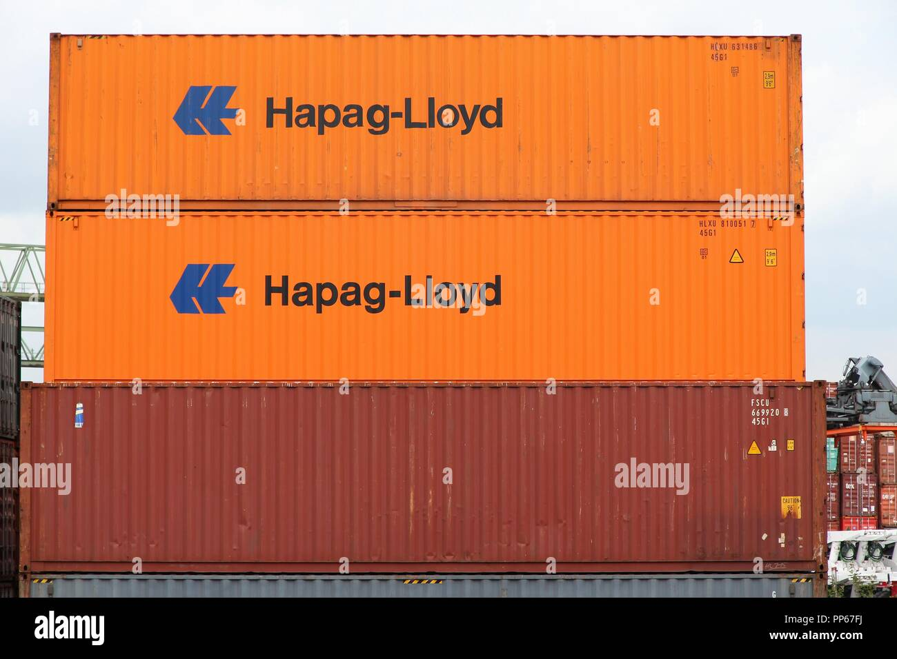 DORTMUND, GERMANY - JULY 16: Hapag Lloyd containers in Dortmund Port on July 16, 2012 in Germany. It is the largest canal port in Europe and had shipp - Stock Image