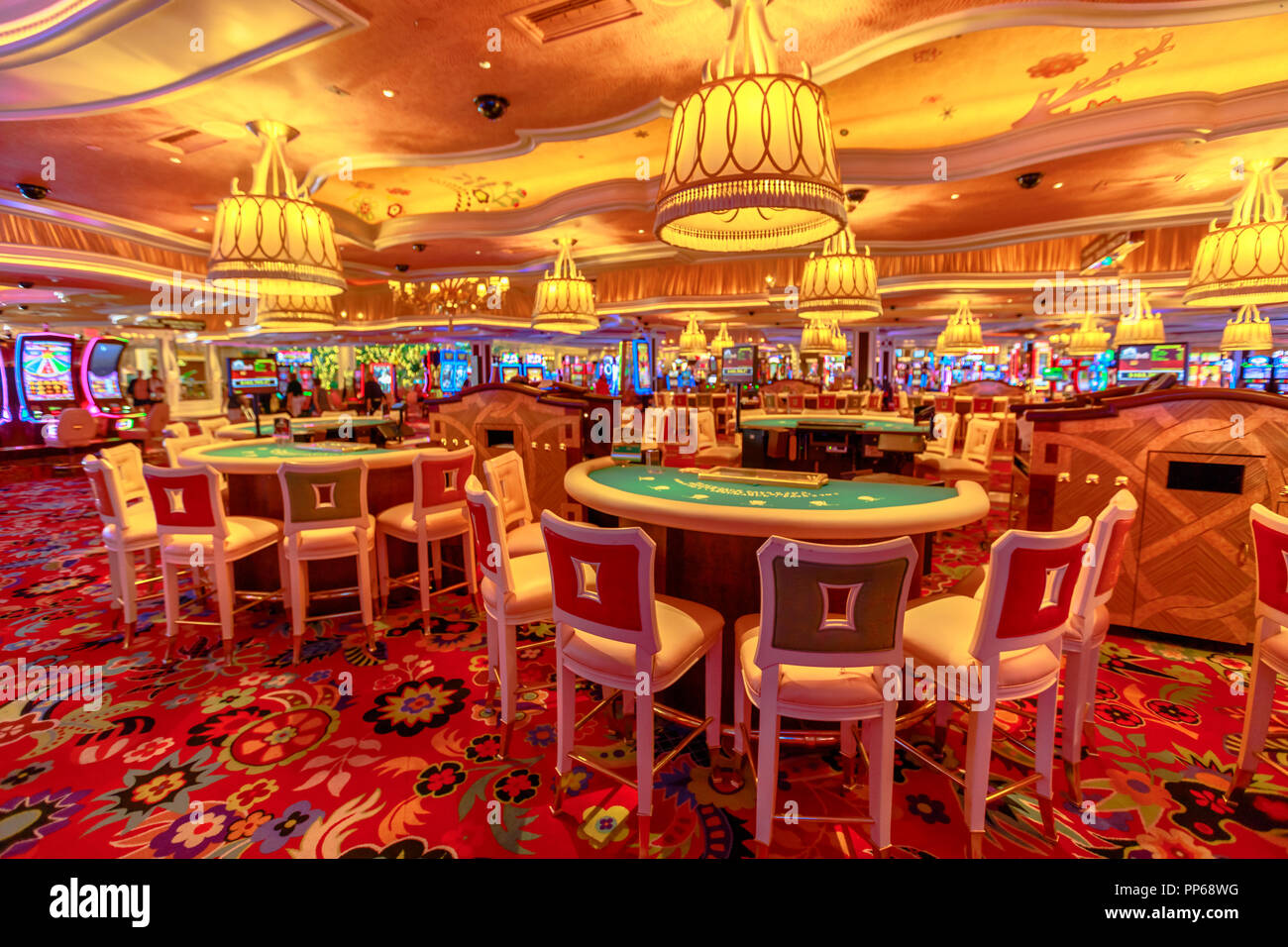 Las Vegas, Nevada, United States - August 18, 2018: blackjack tables and slot machine inside the luxurious Wynn Las Vegas Resort Hotel, a 5-star, themed Paradise in Las Vegas Strip. - Stock Image