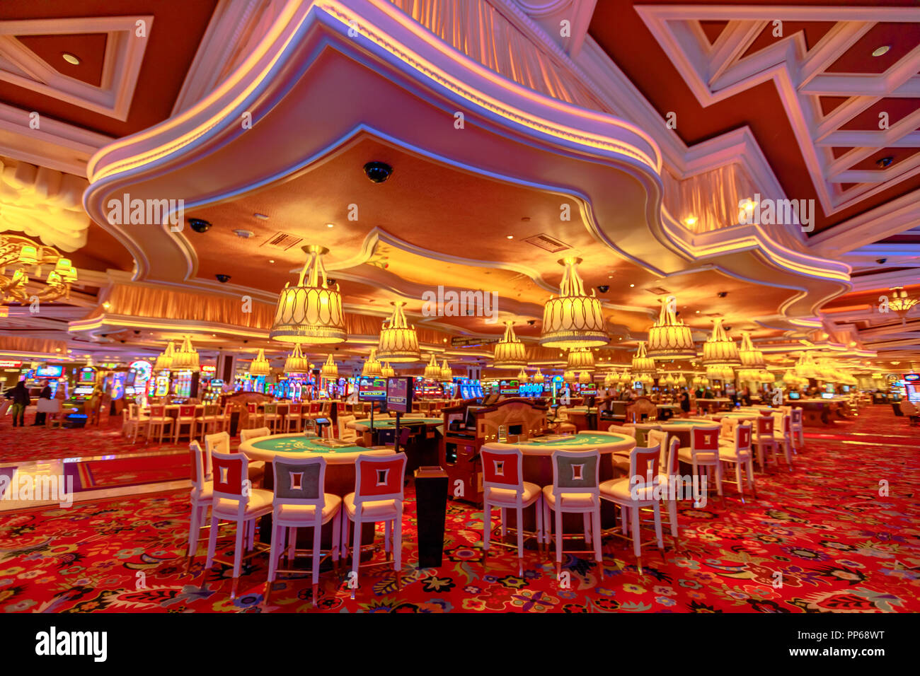 Las Vegas, Nevada, United States - August 18, 2018: rows of blackjack tables and slot machine inside the luxurious Wynn Las Vegas Resort Hotel, a 5-star, themed Paradise Las Vegas Strip, Nevada. - Stock Image