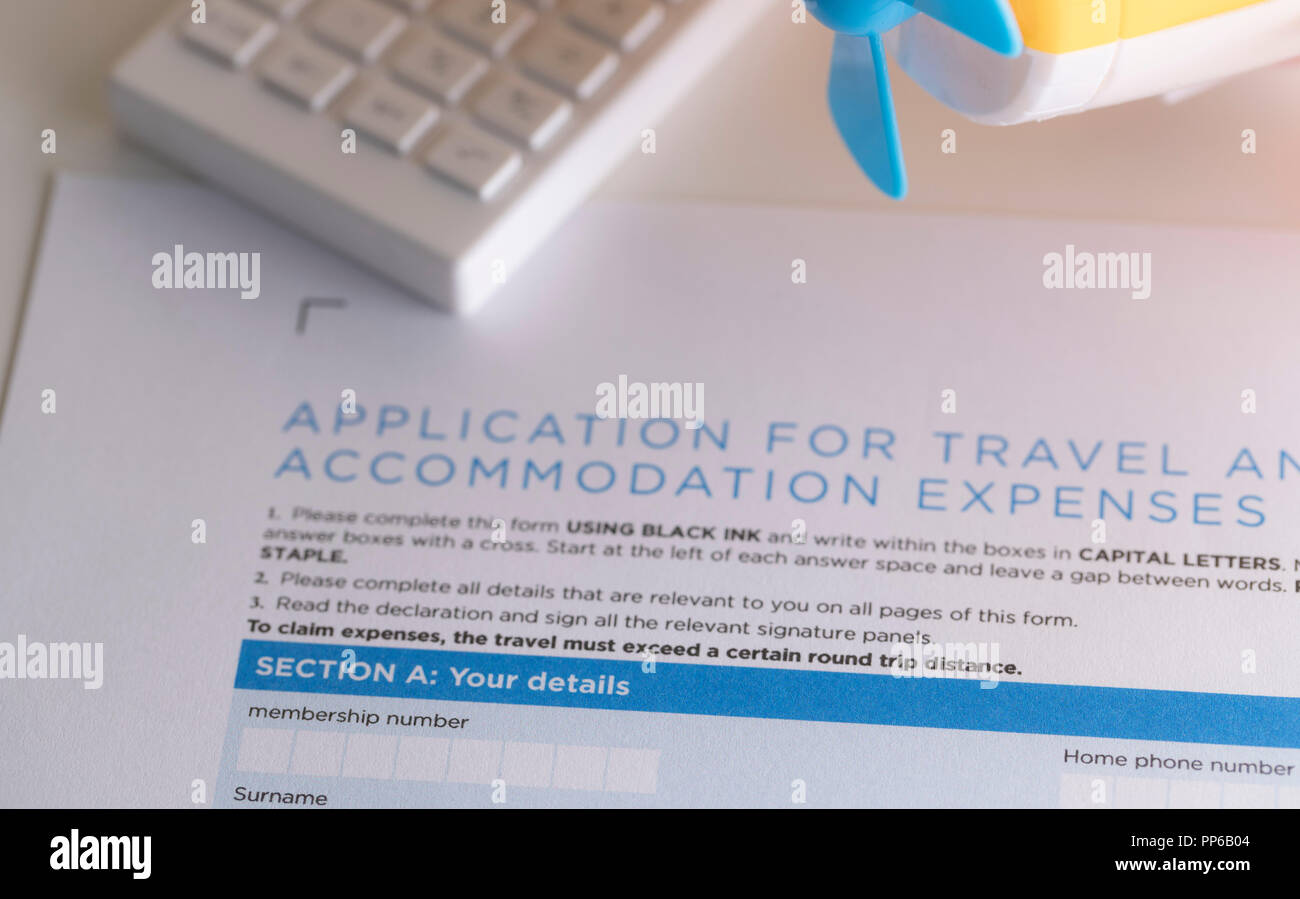 application form for travel with calculator and airplane model on