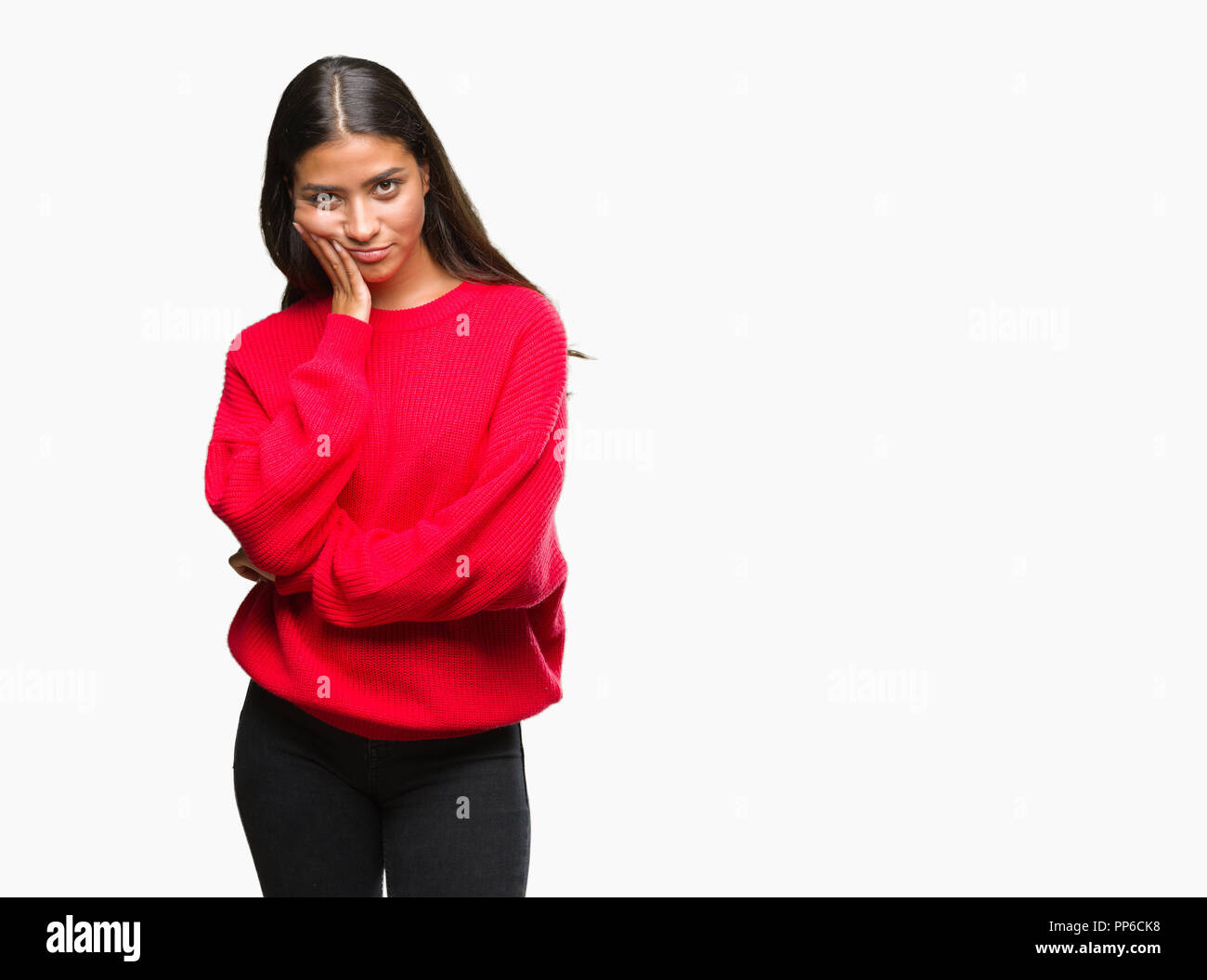 Young beautiful arab woman wearing winter sweater over isolated background thinking looking tired and bored with depression problems with crossed arms Stock Photo