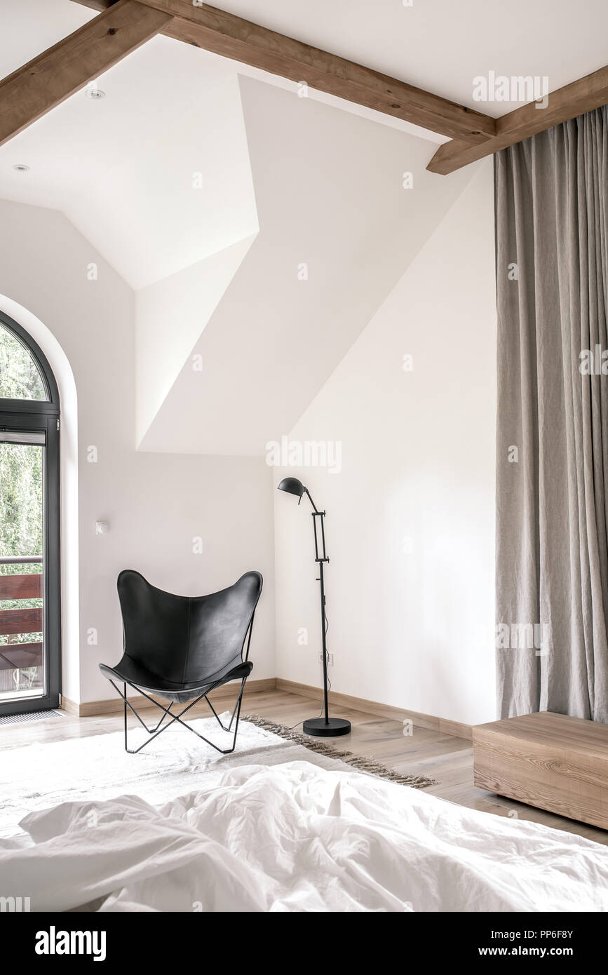 Fancy modern bedroom with white walls, parquet with a carpet ...