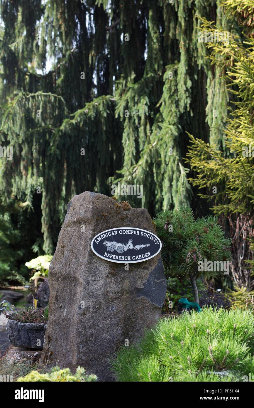 A sign at the entrance to the conifer garden at the Oregon Garden in Silverton, Oregon, USA. - Stock Image