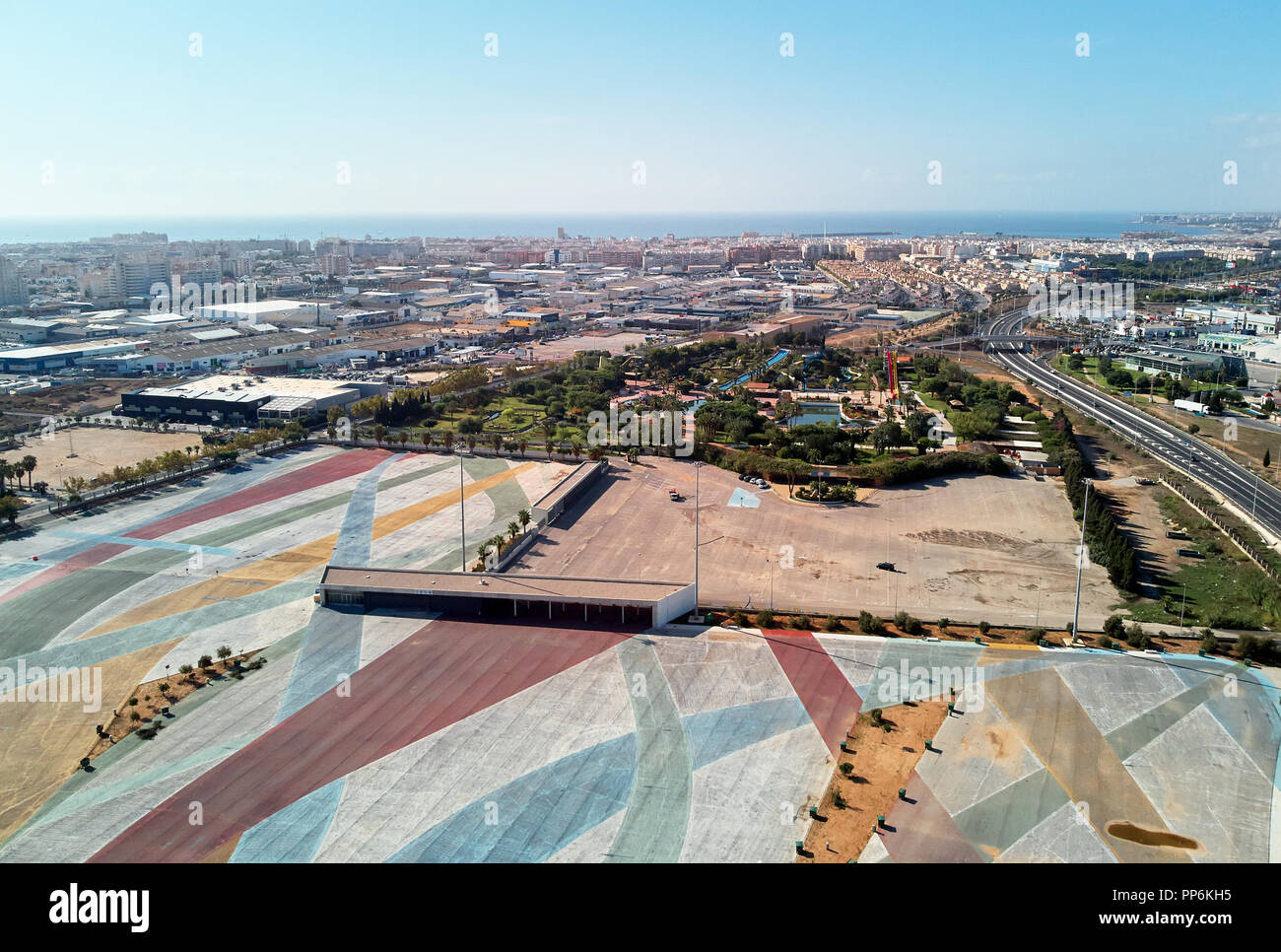 Aerial photography Torrevieja townscape. Above view of empty market parking area, square for transport. Costa Blanca, Spain - Stock Image