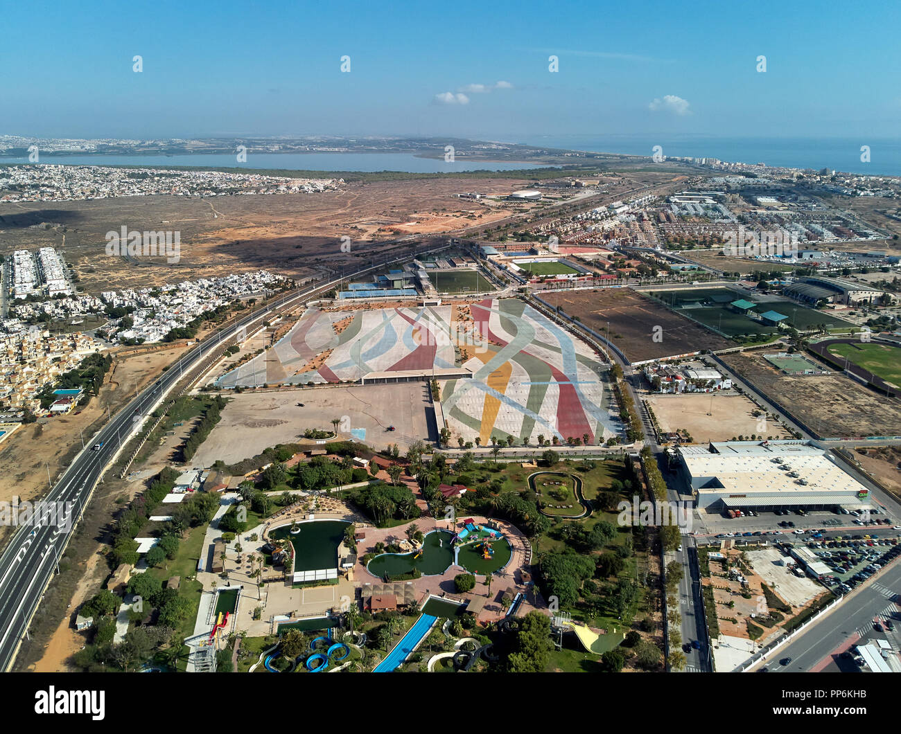 Aerial photography townscape, water park famous popular place of Torrevieja. Above view of empty market parking area, square for transport. Spain - Stock Image
