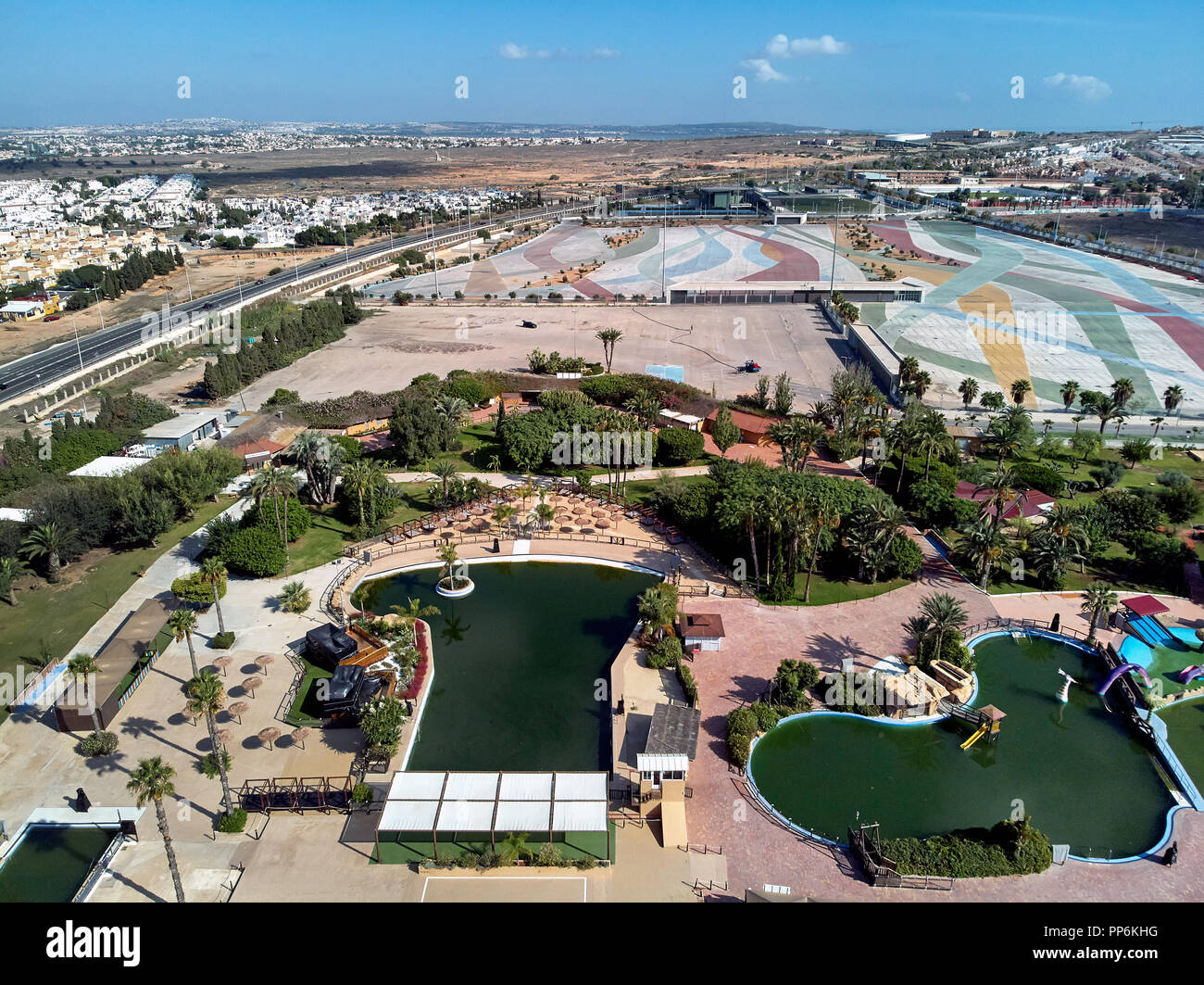 Aerial photography townscape, water park famous popular place of Torrevieja. Above view of empty market parking area, square for transport. Torrevieja - Stock Image