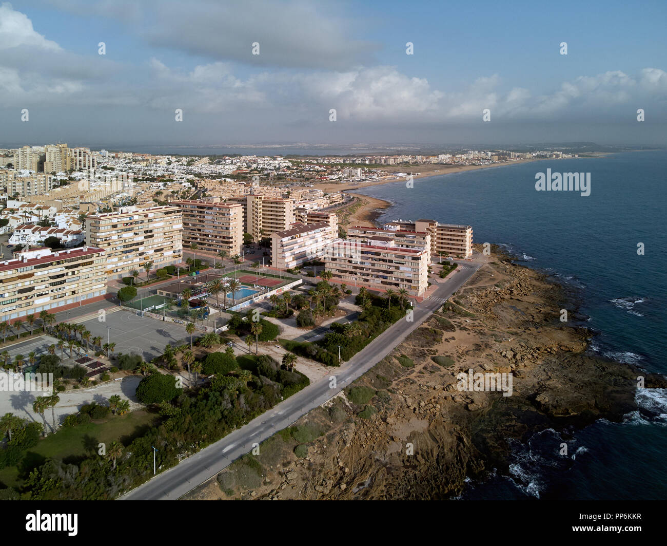 Aerial photography La Mata residential district, Torrevieja townscape. Rocky coast blue Mediterranean Sea top above view. Famous place for travellers  - Stock Image