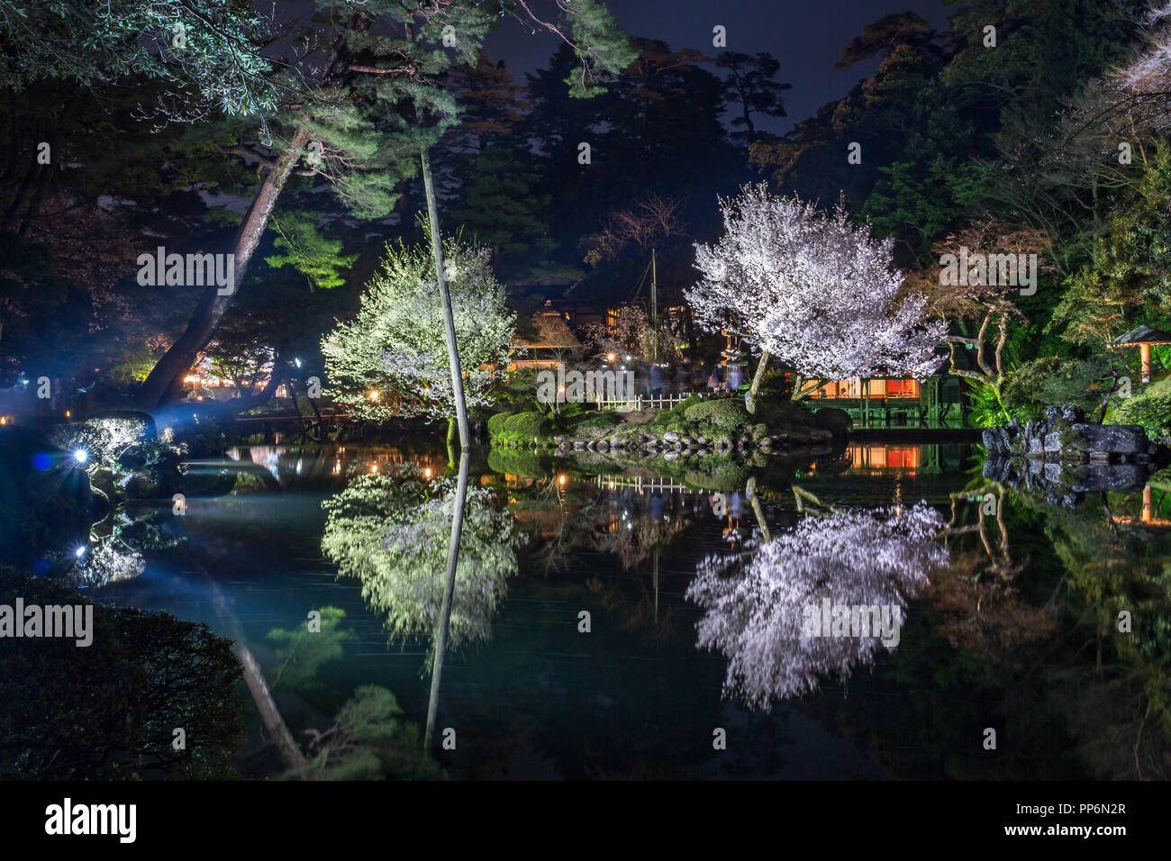 Kenrokuen gardens by night, reflected in water, Kanazawa, Japan - Stock Image