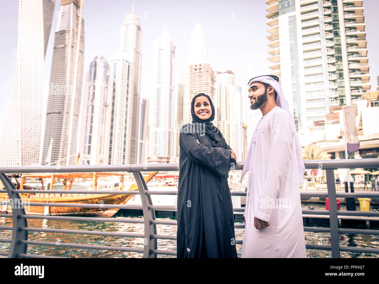 Arabic couple with traditional clothes dating outdoors Stock