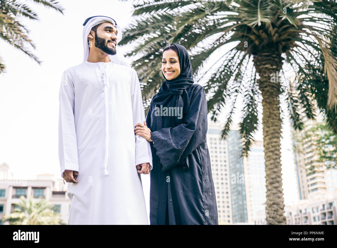 Arabic couple with traditional clothes dating outdoors Stock Photo