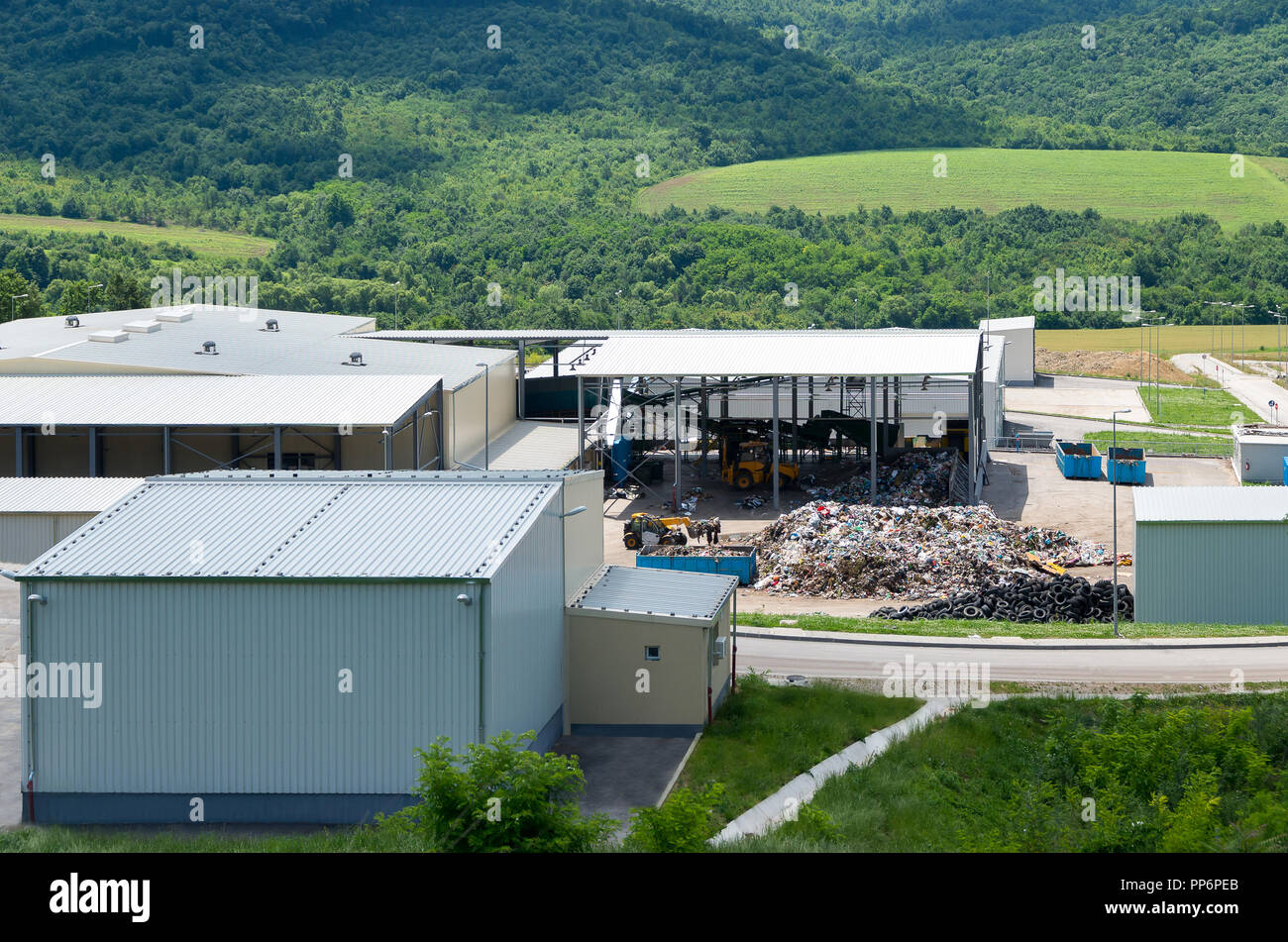 Waste treatment plant depot. Urban landfill built under the program Environment with a grant from the European Union. - Stock Image