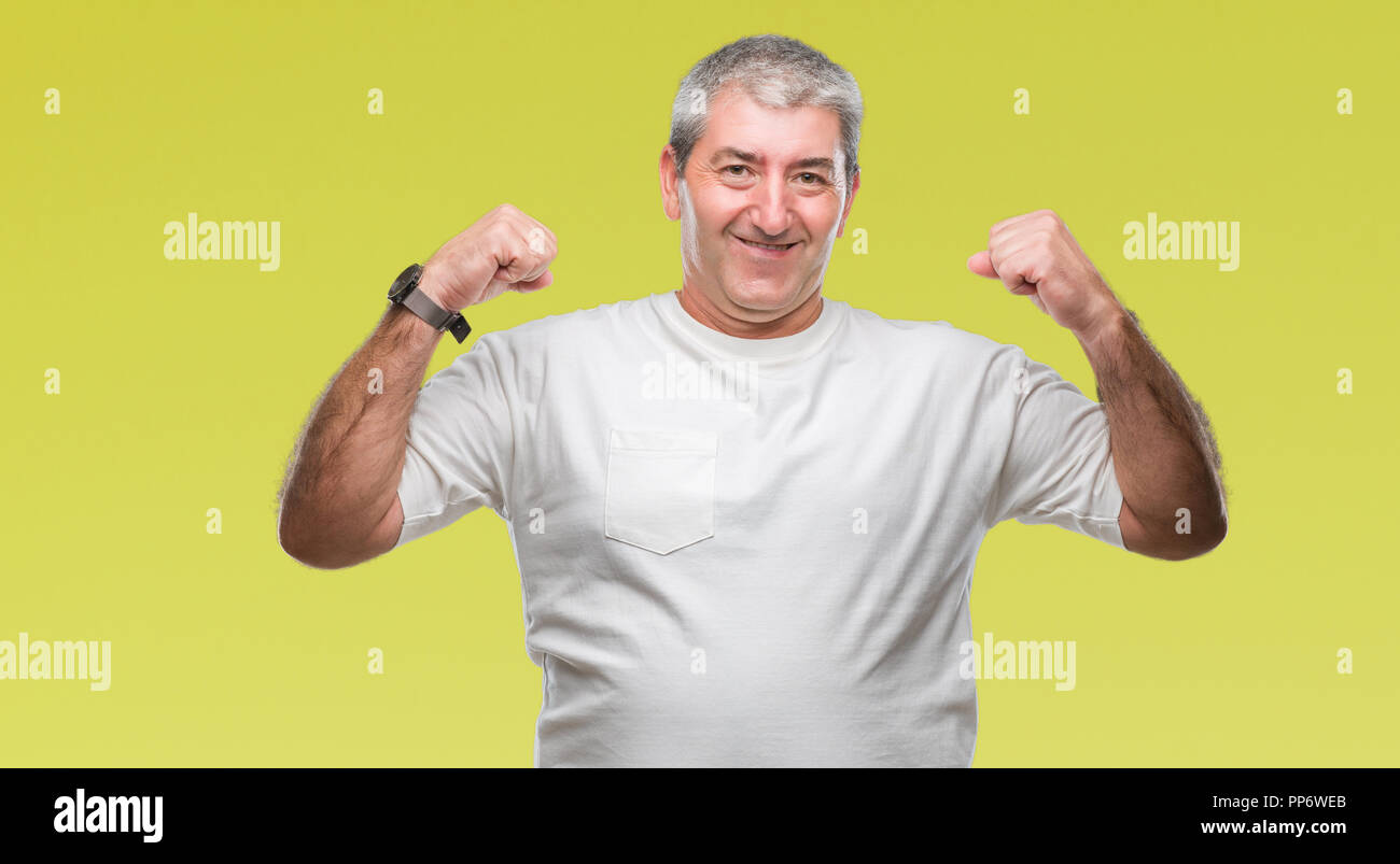 Handsome Senior Man Over Isolated Background Showing Arms Muscles