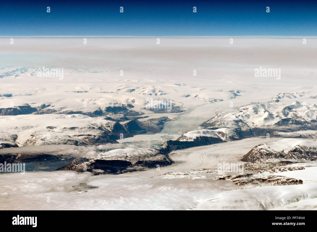 Aerial view of Greenland, glaciers, glacial melt, ice flows and blue pools - Stock Image
