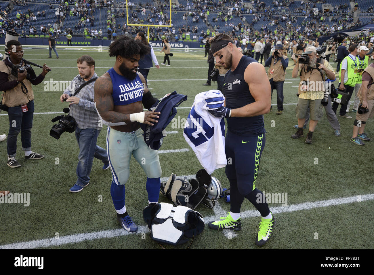 Seattle s NICK VANNETT (81) and the Cowboys EZEKIEL ELLIOTT (21) get ready  to trade jerseys after the Seahawks beat the Cowboys 24-13 in a NFL game ... bec53f430