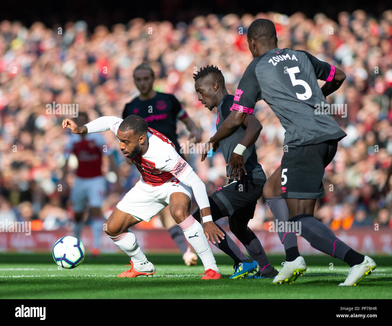 London, UK. 23rd Sep, 2018. Alexandre Lacazette (L) of Arsenal competes during the English Premier League match between Arsenal and Everton at the Emirates Stadium in London, Britain on Sept. 23, 2018. Arsenal won 2-0. Credit: Marek Dorcik/Xinhua/Alamy Live News Stock Photo