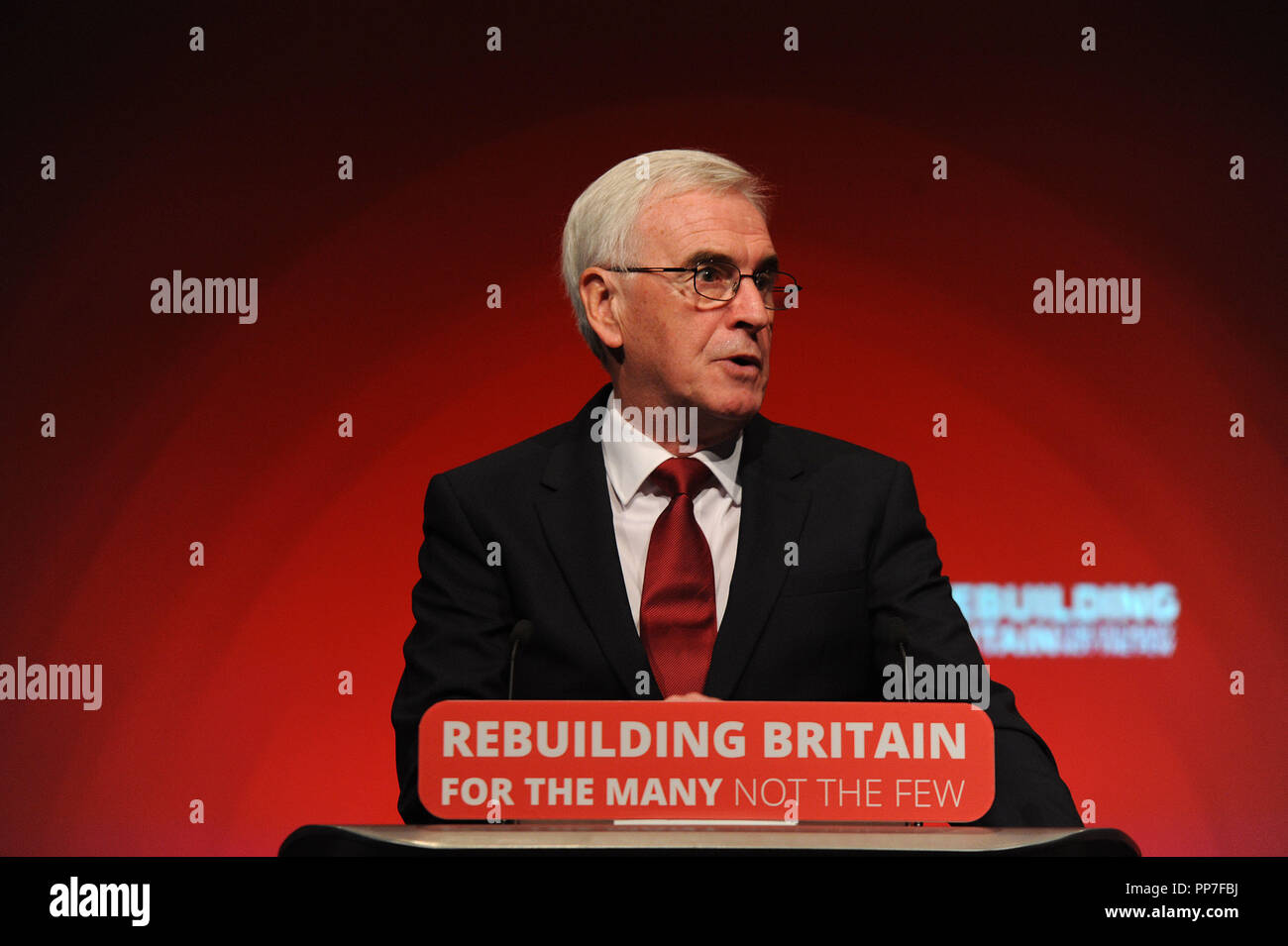 Liverpool, UK. 24th Sep, 2018. John McDonnell MP, Shadow Chancellor, delivering his keynote speech on the theme of Private Investment and Ownership, on the morning session of the second day of the Labour Party annual conference at the ACC Conference Centre. Credit: Kevin Hayes/Alamy Live News - Stock Image