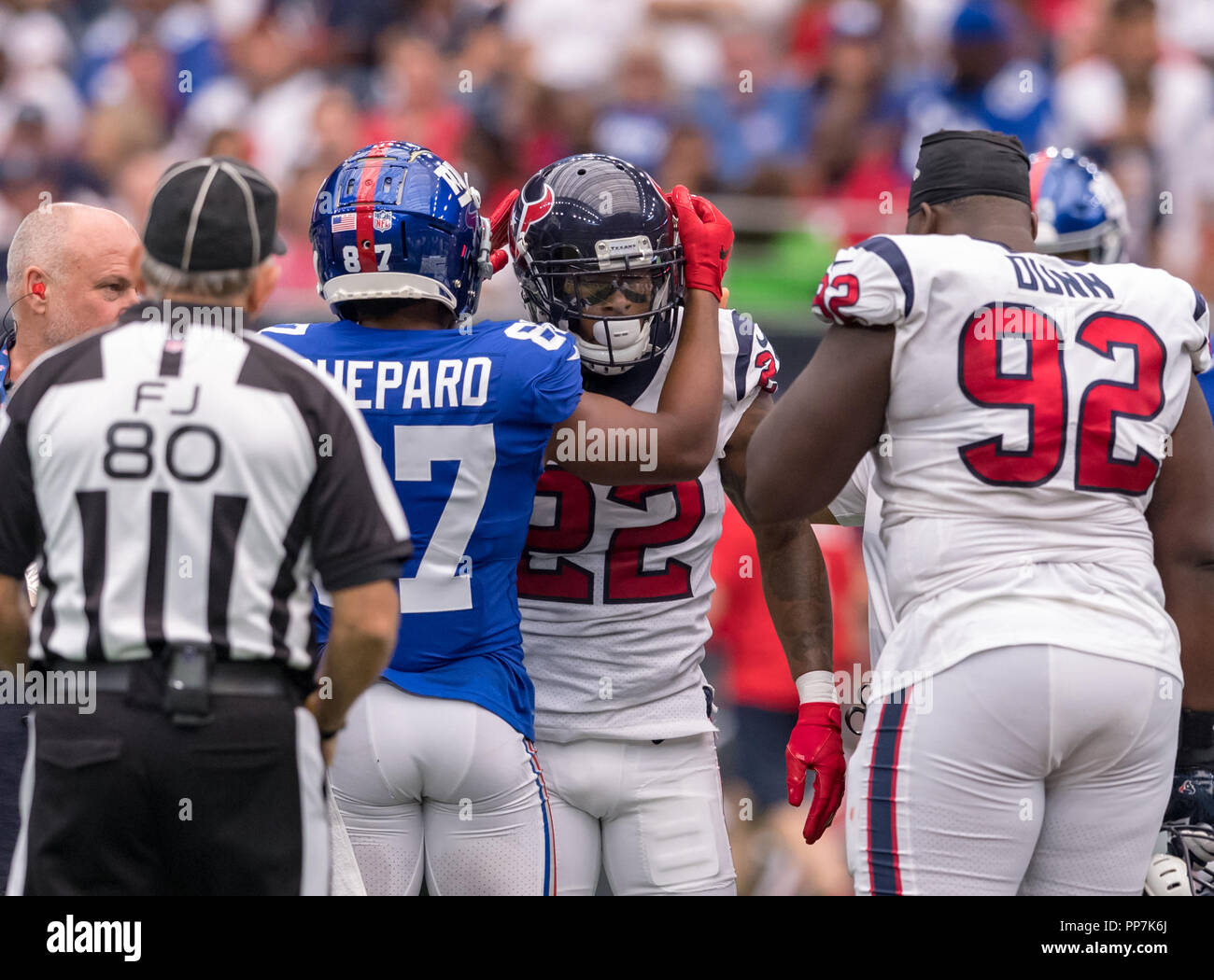 New York Giants wide receiver Sterling Shepard (87) checks on Houston Texans defensive back Aaron Colvin (22) after an injury time out for Aaron Colvin returns later in the game in an NFL game between the New York Giants and the Houston Texans on September 23, 2018 at the NRG Stadium in Houston, Texas. The New York Giants beat the Houston Texans final 27-22 - Stock Image