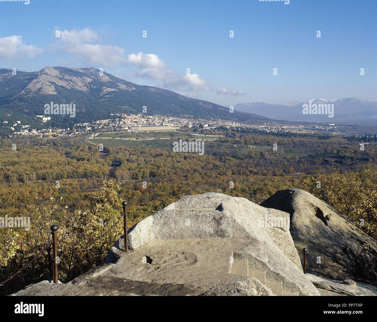 Spain. Community of Madrid. Panorama of San Lorenzo de El Escorial and the Monastery of El Escorial from the Chair of Philiph II, digging in granite rock where the monarch followed the progress of work of the monastery. Stock Photo