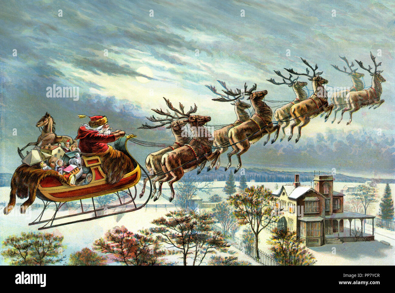 santa claus and his reindeer delivering christmas gifts stock photo