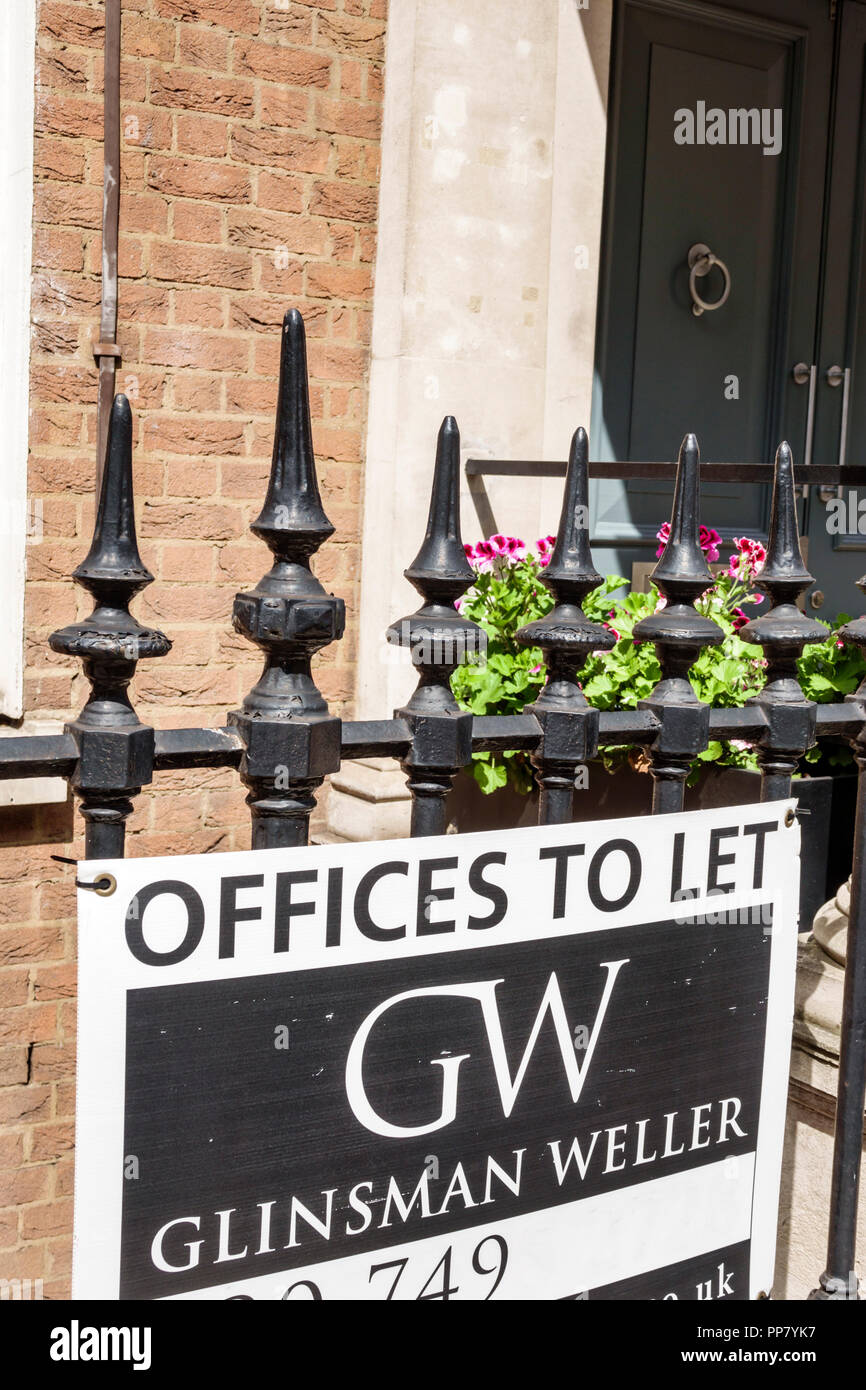 London England United Kingdom Great Britain West End City Westminster Mayfair offices to let sign commercial real estate Glinsman Weller wrought iron - Stock Image