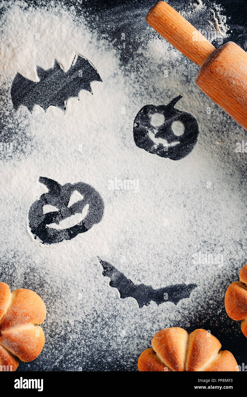 Drawing Halloween Decorations On Flour Background Cakes In