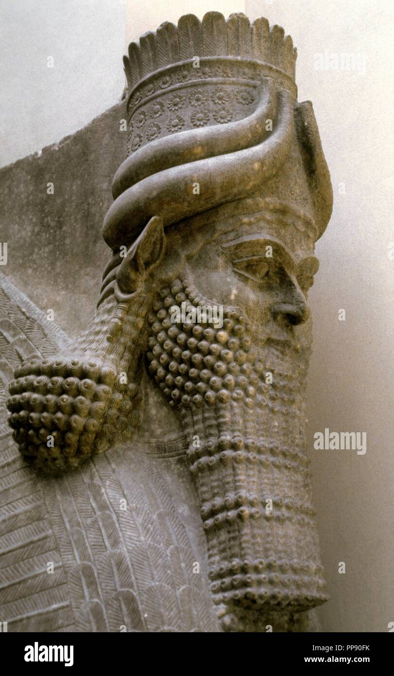 Lamassu from the Palace of Sargon II. Assyrians. Detail of Head. 706 BC. Khorsabad Palace. Louvre Museum. Paris. France. - Stock Image