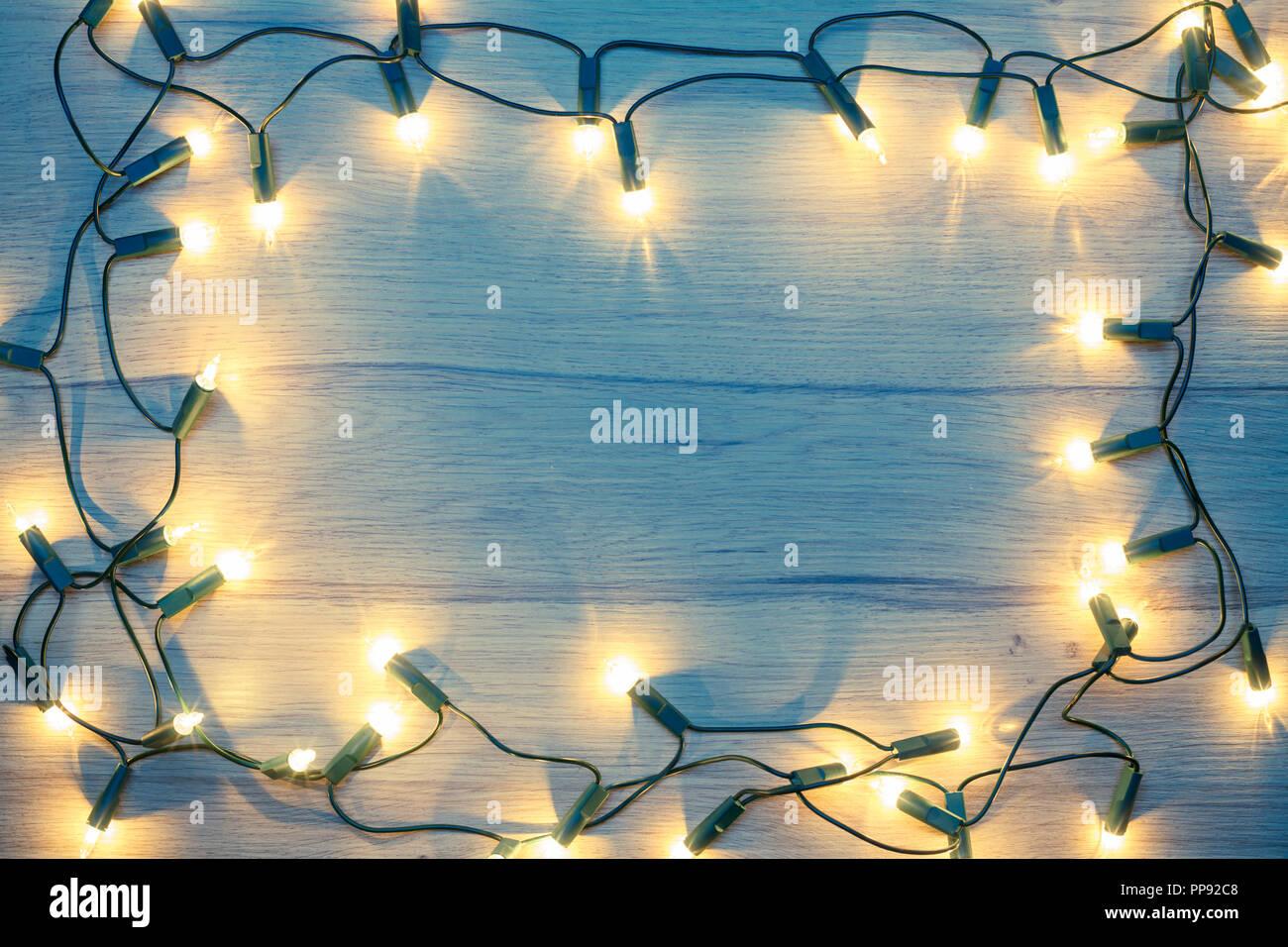 christmas lights frame on a wood toned - Christmas Lights Frame